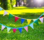 Banderas coloridas del partido hechas del papel Fotografía de archivo libre de regalías