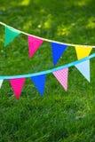 Banderas coloridas del partido hechas del papel Foto de archivo libre de regalías