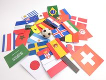 Banderas con la bola del fútbol isloated en blanco Imagen de archivo
