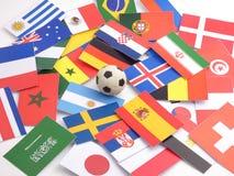 Banderas con la bola del fútbol isloated en blanco Foto de archivo