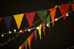Banderas con las guirnaldas en noche Imágenes de archivo libres de regalías