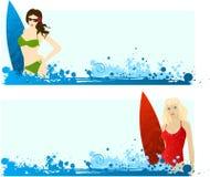 Banderas con las muchachas que practican surf Fotografía de archivo