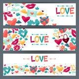Banderas con los iconos de la tarjeta del día de San Valentín y de la boda Foto de archivo