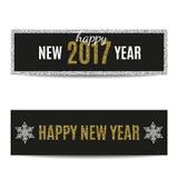 Banderas copos de nieve de oro del texto de la Feliz Año Nuevo 2017 y de la plata Imagenes de archivo