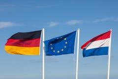 Banderas de Alemania, de Países Bajos y de la UE Imagen de archivo libre de regalías