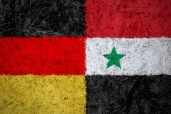 Banderas de Alemania y de Siria Imágenes de archivo libres de regalías