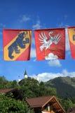 Banderas de Berna y de Gstaad Imagen de archivo libre de regalías