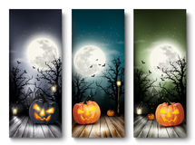 Banderas de Halloween del día de fiesta con las calabazas y la luna Imagen de archivo libre de regalías