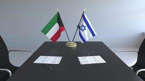 Banderas de Kuwait y de Israel y papeles en la tabla Negociaciones y firma de un acuerdo internacional 3D conceptual libre illustration