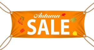 Banderas de la materia textil con Autumn Sale Text Suspended cerca Foto de archivo libre de regalías