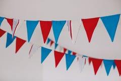 Banderas de la tela en el sitio blanco Foto de archivo