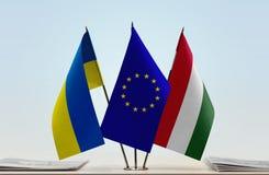 Banderas de la unión europea y de Hungría de Ucrania imagen de archivo libre de regalías