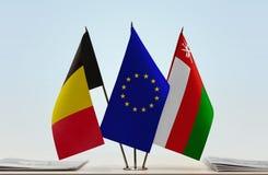 Banderas de la unión europea y de Omán de Bélgica ilustración del vector