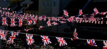 Banderas de las conmemoraciones BRITÁNICAS de domingo de la conmemoración en Diss Imagen de archivo libre de regalías