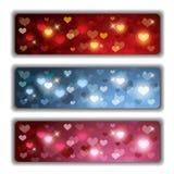 Banderas de las tarjetas del día de San Valentín con los corazones brillantes coloridos Fotos de archivo libres de regalías