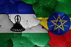 banderas de Lesotho y de Etiopía pintados en la pared Imagen de archivo libre de regalías