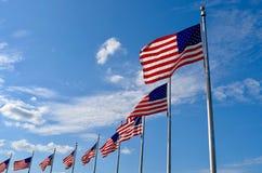 Banderas de los E.E.U.U. que agitan Imagen de archivo libre de regalías