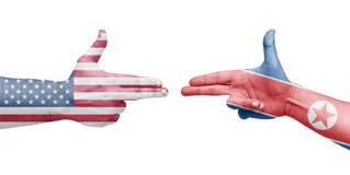 Banderas de los Estados Unidos y de Corea del Norte bajo la forma de handgu Fotografía de archivo