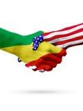 Banderas de los países de Congo y de Estados Unidos, apretón de manos sobreimpreso Foto de archivo libre de regalías