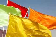 Banderas de Marruecos que agitan contra el cielo azul Imagen de archivo