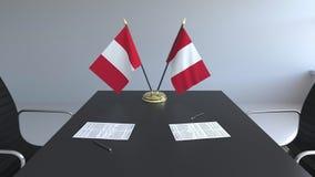 Banderas de Perú y de papeles en la tabla Negociaciones y firma de un acuerdo Animación conceptual 3D almacen de metraje de vídeo