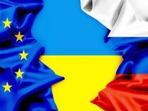 Banderas de Ucrania, de la UE y de Rusia. Conflicto. Imagenes de archivo
