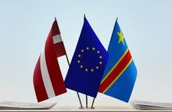 Banderas de UE y del Manual del Transportista de República Democrática del Congo, DROC, Congo-Kinshasa de Letonia imagen de archivo libre de regalías