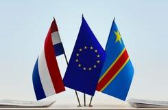 Banderas de UE y del Manual del Transportista de República Democrática del Congo, DROC, Congo-Kinshasa de Países Bajos foto de archivo libre de regalías