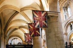 Banderas de Union Jack en una iglesia Imagen de archivo libre de regalías