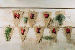 Banderas decorativas con el Año Nuevo de la inscripción Foto de archivo libre de regalías