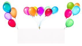 Banderas del día de fiesta con los globos coloridos Imagen de archivo