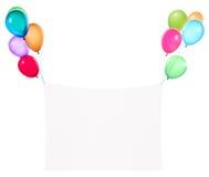 Banderas del día de fiesta con los globos coloridos Foto de archivo