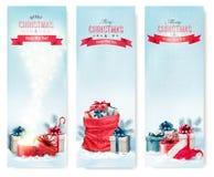 Banderas del invierno de la Navidad con los presentes Imagenes de archivo