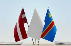 Banderas del Manual del Transportista de Letonia y de República Democrática del Congo, DROC, Congo-Kinshasa imagenes de archivo
