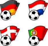 Banderas del mundo y balón de fútbol Imagenes de archivo