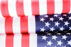 Banderas dobladas primer - concepto del patriotismo Foto de archivo