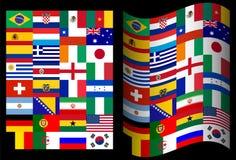 Banderas en el mundial en el negro del Brasil Fotos de archivo libres de regalías