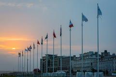 Banderas en la puesta del sol Imágenes de archivo libres de regalías