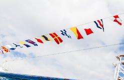Banderas en la travesía Foto de archivo