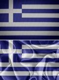 Banderas griegas de la tela Foto de archivo libre de regalías