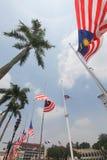 Banderas malasias en el medio palo después del incidente MH17 Fotografía de archivo libre de regalías