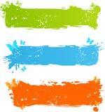 Banderas multicoloras sucias con la mariposa Fotos de archivo