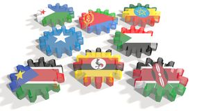 Banderas nacionales de la autoridad de los miembros intergubernamentales del desarrollo en los engranajes ilustración del vector