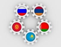 Banderas nacionales eurasiáticas de los miembros de la Comunidad económica en los engranajes Imagen de archivo