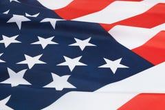 Banderas nacionales rizadas - los Estados Unidos de América Foto de archivo libre de regalías