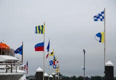 Banderas náuticas en puerto Imagen de archivo libre de regalías