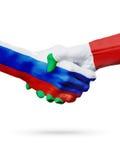 Banderas países de Rusia, Italia, concepto del apretón de manos de la amistad de la sociedad Fotos de archivo libres de regalías
