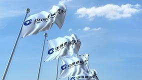 Banderas que agitan con el logotipo de China Construction Bank contra el cielo, representación editorial 3D Imagen de archivo