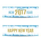 Banderas texto y copos de nieve de oro de la Feliz Año Nuevo 2017 Imagen de archivo