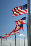 Banderas U.S._6347. American flags flying with blue sky background stock photo
